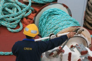 crew member manning the anchor of a ship